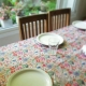 Mantel Impermeable flores fondo beige