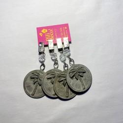 Pesa mantel moneda palmera plata